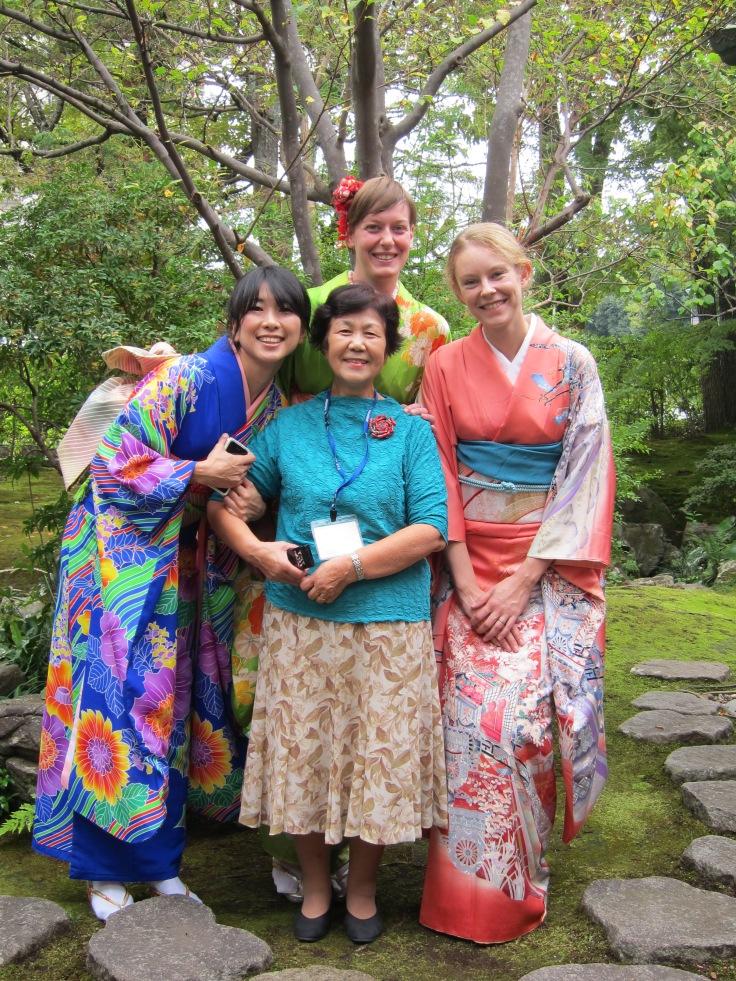 3 girls in a kimono with sensei