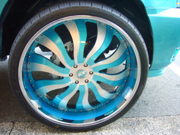The rims on the turqoise car