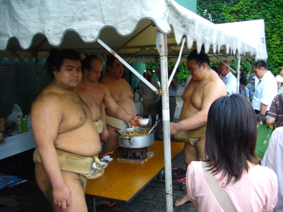 Sumo wrestlers handing out chankonabe