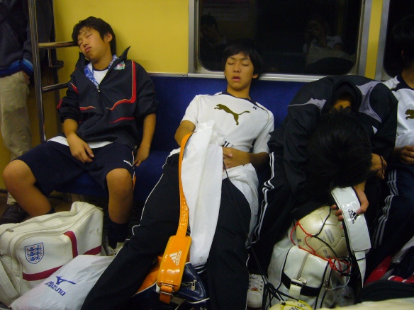 kids sleeping on the train in Japan