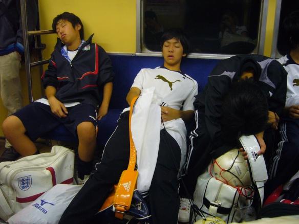 kids sleeping on the train in Japan