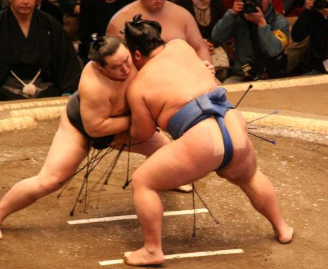 Two wrestlers fighting in their silk mawashi