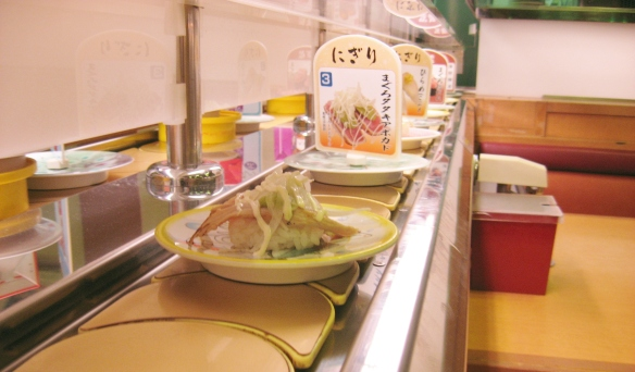 tuna sushi on the conveyer belt