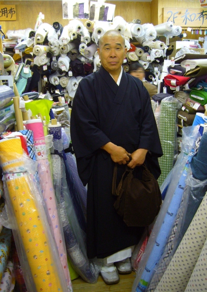 japanese monk in a fabric store
