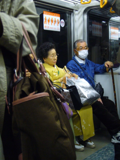 lady in kimono on the train in Japan