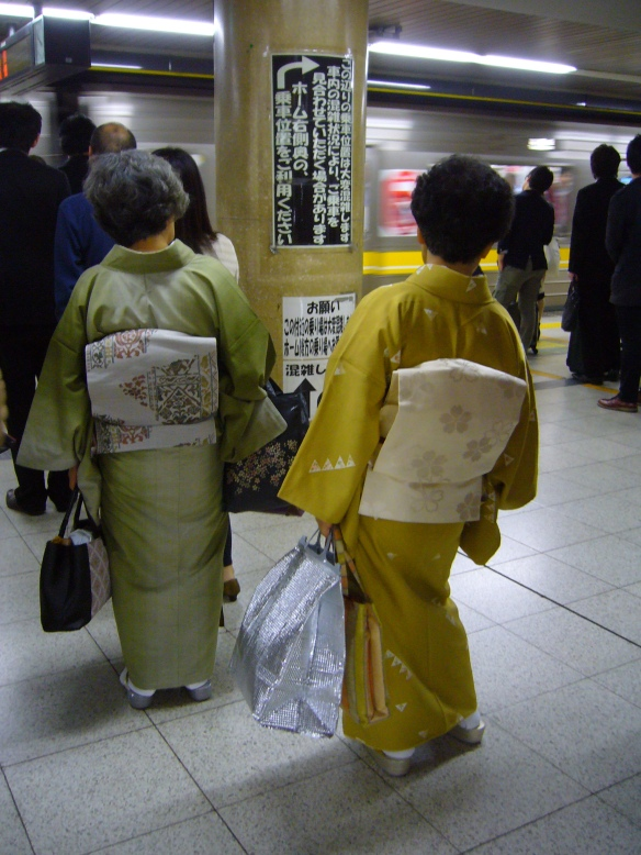 Japanese ladies in kimono waiting for the train
