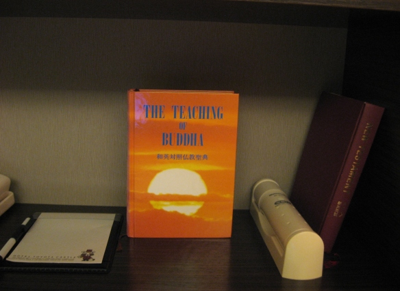 bible and buddhist teachings in a japanese hotel room