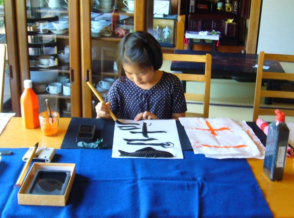japanese calligraphy student practicing the basics