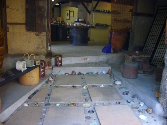 a shop in tokoname with pottery embedded in the floor