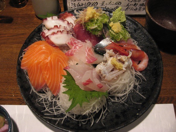 sashimi at an izakaya in japan